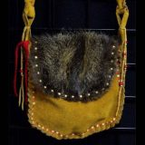 Native American style Shoulder Bag - heavy duty split buckskin suede, hand laced sinew. Nutria pelt on both sides. 48 inch strap and has a 2 inch gusset.
