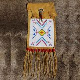 Buckskin Bag is adorned with Loomed Beadwork