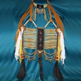 Short style breastplate crafted with a cross design of copper beads and crow beads with brass hawk bells, horsehair, nickel concho, real bone disks