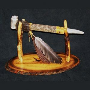 Native American antler pipe with rattlesnake skin and wood display stand.