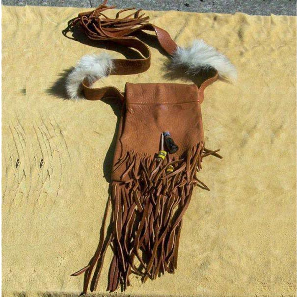 Fringed Possibles Bag, made with heavy elkhide decorated with a polished antelope antler tip, old style painted glass beads, tin cones, and coyote fur